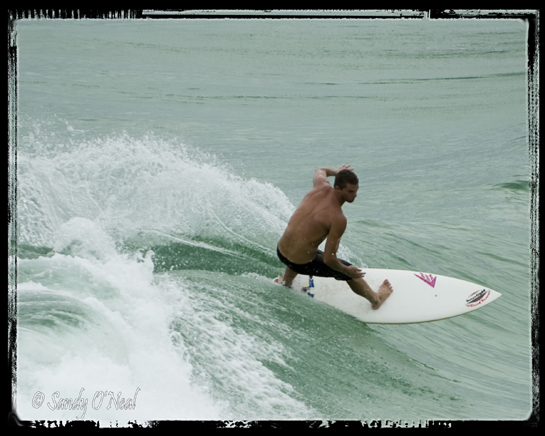 Surfing at Navarre Beach
