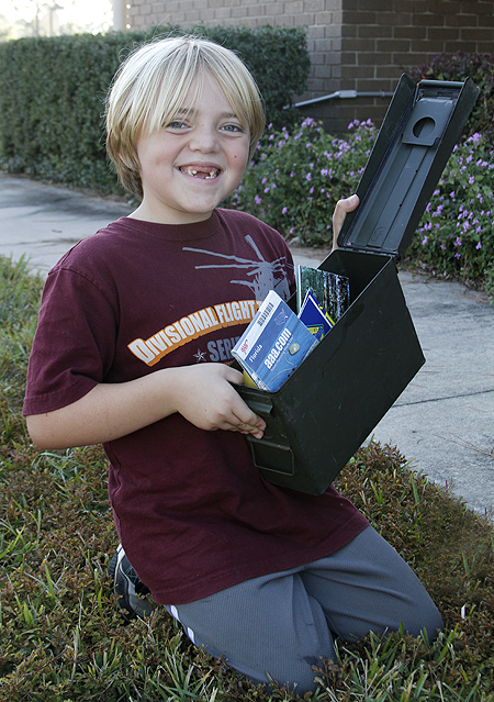 Our son holding the geocache we found
