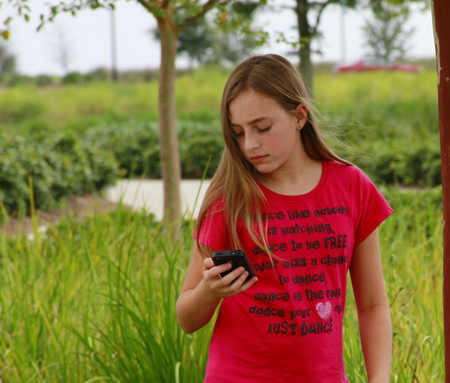Our daughter using an iPhone to located a geocache