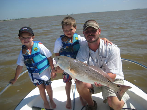 Adam Barker and his two boy's Noah and Kaleb with a nice Alabama redfish.